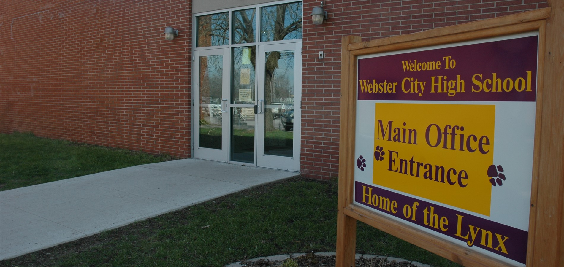 Webster City High School main building entrance and welcome sign