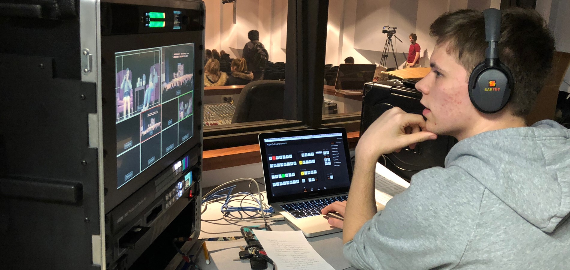 Picture of student working in the video broadcasting control room in the auditorium