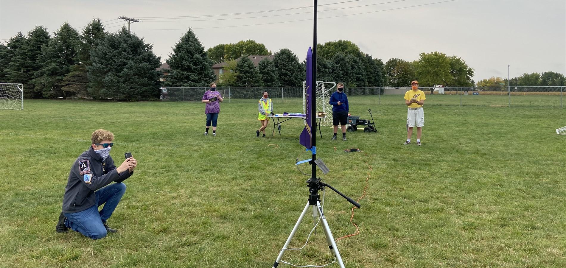 High school students getting ready to launch a model rocket